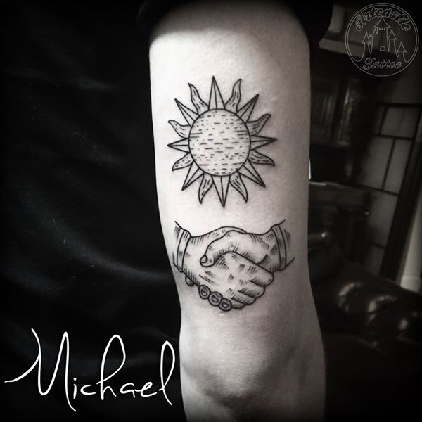 ArtCastleTattoo Tattoo ArtiestMichael Traditional sun and handshake tattoo blackwork back of arm Old School