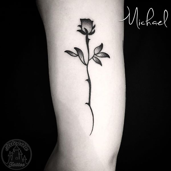 ArtCastleTattoo Tattoo ArtiestMichael blackwork minimalistic rose tattoo black n grey on arm Blackwork