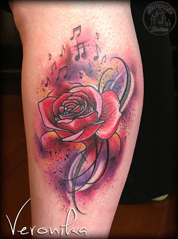 ArtCastleTattoo Tattoo ArtiestVeronika Colorful rose with music notes and bright colors on lower leg Watercolor