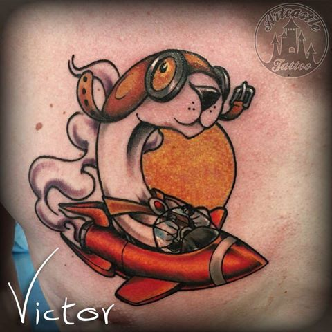 ArtCastleTattoo Tattoo ArtiestVictor New school dog in airplane tattoo on chest Kleur Color