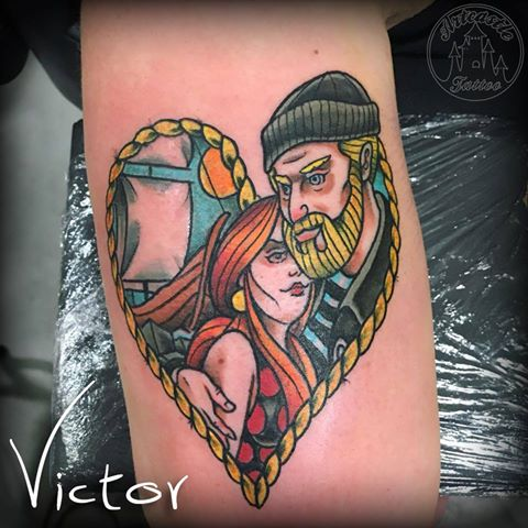 ArtCastleTattoo Tattoo ArtiestVictor Old school sailor couple heart tattoo color on arm Traditioneel zeeman en vrouw koppel hart tattoo op arm Color