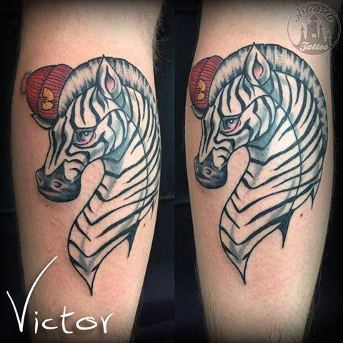 ArtCastleTattoo Tattoo ArtiestVictor Zebra tattoo with a Wu Tang hat Kleur Color