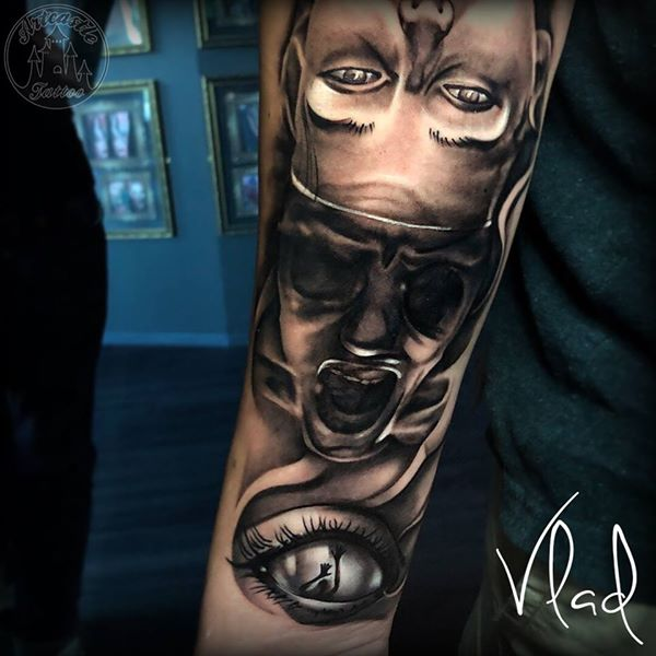 ArtCastleTattoo Tattoo ArtiestVlad Realistic Eye face morph tattoo lower arm Black n Grey